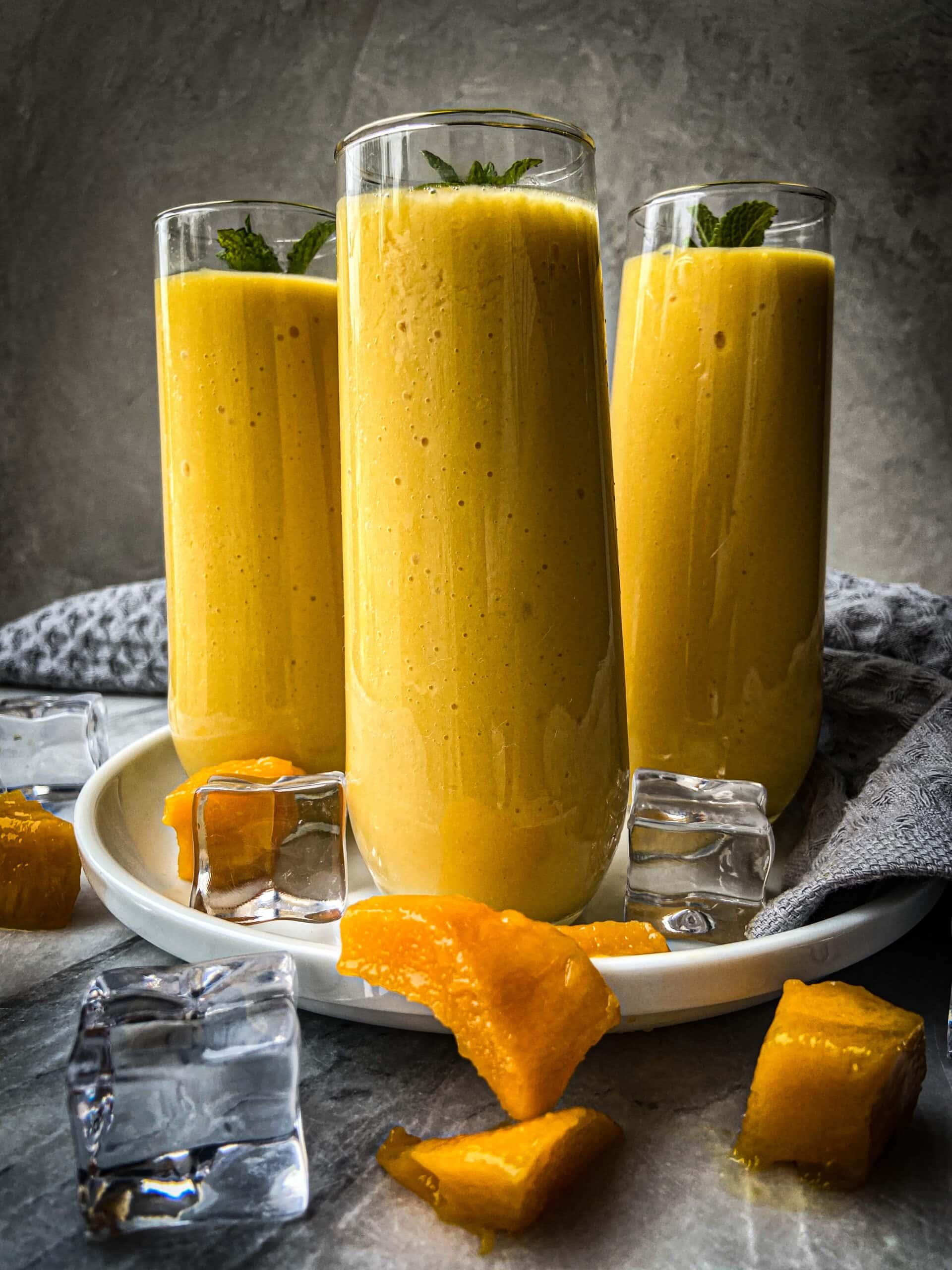 3 tall glasses of mango lassi