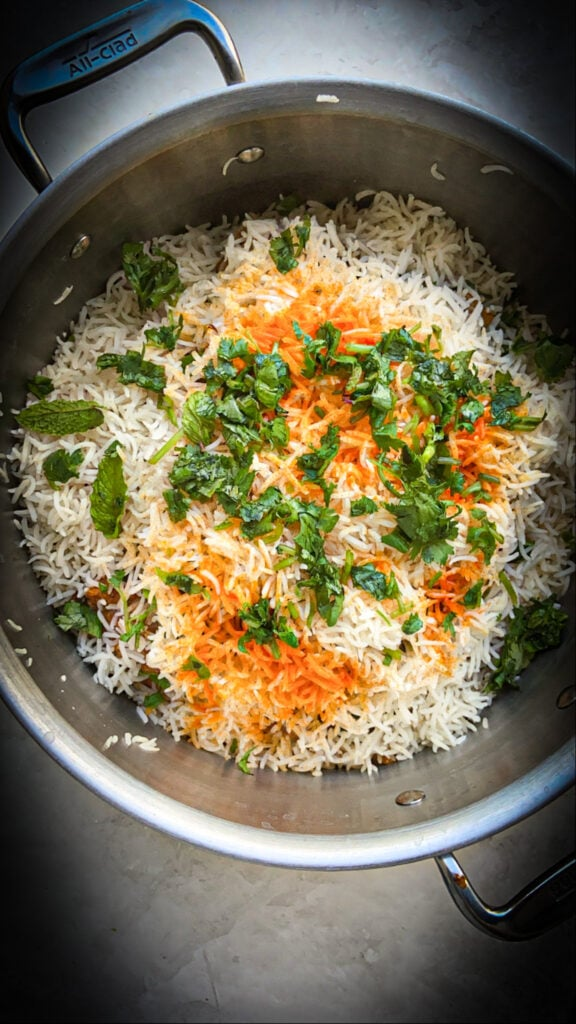 the top layer with rice, cilantro, and mint